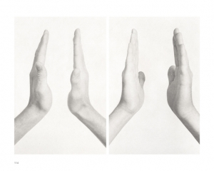A black and white photograph of 2 sets of hands, open and pointing upwards, with space between them.