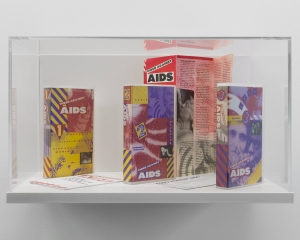 "A vitrine that contains 2 tapes and a program for the ""Video Against AIDS"" program"