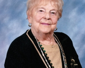 A photograph of an elderly white woman against a black background