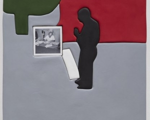An artwork by Sadie Benning that is gray, red, and green. It depicts a figure's silhouette in black with a small square black and white photograph of a man at his desk with papers around it.