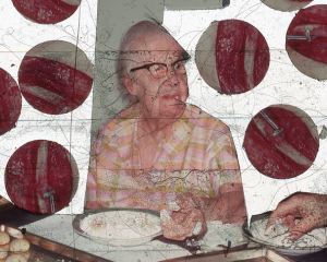 An image from a slide in Price's film. There is a granny with black glasses sitting at a table. Surrounding her are 6 circles that are excerpted images and depict red muscle.