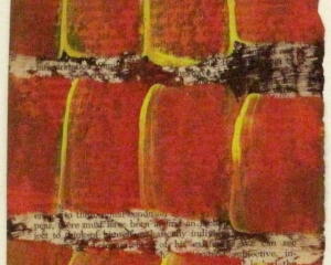 Red and yellow paint applied to a page of text from a book