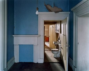 A photograph of a home interior with blue walls and white moulding and details