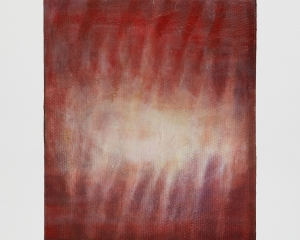 A painting on canvas that is predominantly red, with a burst of light seemingly coming from the center of the canvas. There are some striations horizontally.