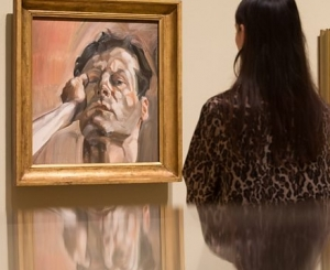 Viewer observing Lucian Freud work at Royal Academy