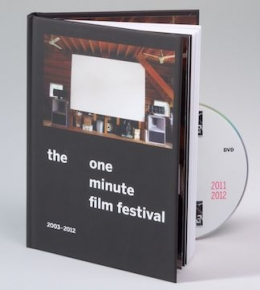 A photograph of the book propped open with the DVD peeking out the right side