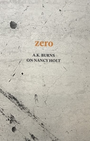 "The front cover of ""A.K. Burns on Nancy Holt,"" with a photograph of zoomed-in concrete on the cover"