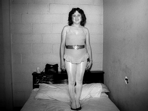 Woman standing on bed by Scot Sothern