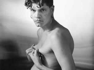 Man pulling nipples by Stephen Barker
