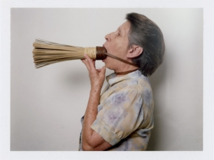 Woman with broom by Benjamin Fredrickson