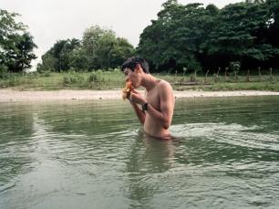 Boy in river by Alex Morel