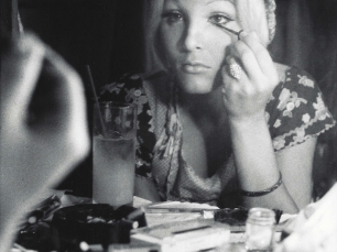 Woman applying make up by Anthony Friedkin