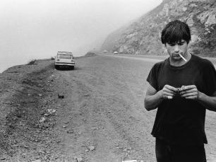 Man smoking by Anthony Friedkin