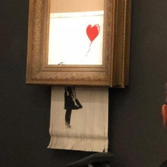 Banksy Painting Self-Destructs After Reaching a Record $1.4 Million at Auction