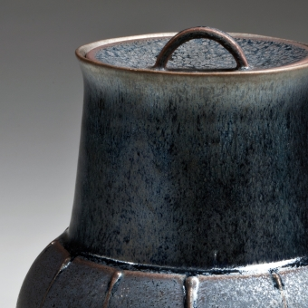glazed water jar with semi-globular base, flaring neck, and recessed lid with arched handle