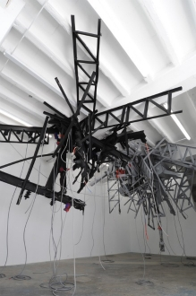 Mia Feuer Fire Escapism (suspended sculpture) 2011, styrofoam, FGR, latex paint, spray paint, cardboard, found model ship, approx. 72 x 60 x 48 inches