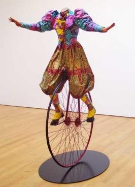YINKA SHONIBARE, Lady on Unicycle, 2005. Life-size fiberglass mannequin, Dutch wax-printed cotton, steel