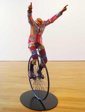 YINKA SHONIBARE, Child on Unicycle, 2005. Life-size fiberglass mannequin, Dutch wax-printed cotton, steel