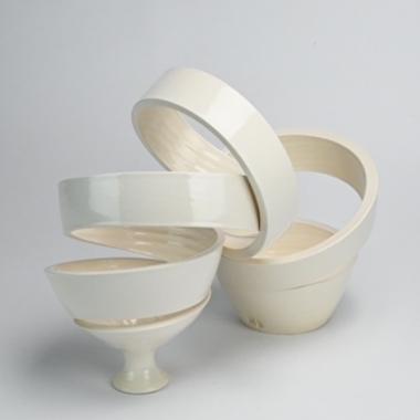 Sculpture by Michael Boroniec tilted Spatial Spiral: Arc, white ceramic arc shaped spiral sculpture