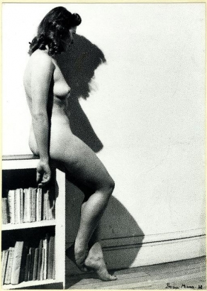 Dora Maar - Assia—Profile Posing Naked Sitting on the Edge of a Library, 1938 Gelatin silver print mounted to board, printed c. 1938   Bruce Silverstein Gallery