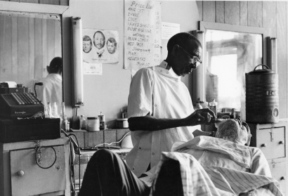Chester Higgins - Barbershop, Tuskegee, Alabama, 1972  | Bruce Silverstein Gallery