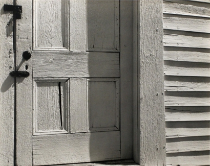 Edward Weston- Church Door, Hornitos, 1940 Gelatin silver print mounted to board   Bruce Silverstein Gallery