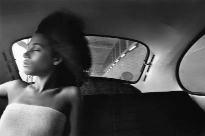 Chester Higgins - Ann Young in VW Bug, Manhattan, 1975  | Bruce Silverstein Gallery