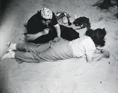 Weegee - Coney Island (Sewing Pants), 1940 | Bruce Silverstein Gallery