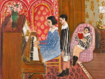 This is an image of Henri Matisse's painting, The Piano Lesson painted in 1923, which represent a domestic scene, featuring a young woman playing the piano wearing a blue dress, next to her a young boy is listening and standing. Another child is sitting on the right in a pink sofa, reading a book. The two alums are wearing a top with black and white stripes and a white collar as well as a white short. The overall tons of the paintings are rich browns, reds and pink.