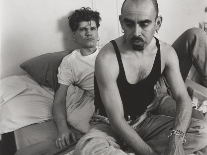 Men on bed by Stephen Barker