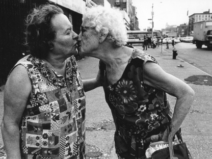 Two women kissing by Arlene Gottfried