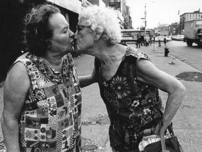 Two women kissing by Arlene Gottfried