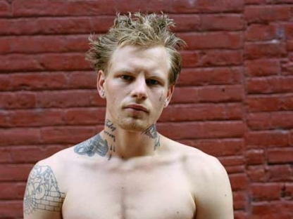 Man with tattoos by Tema Stauffer