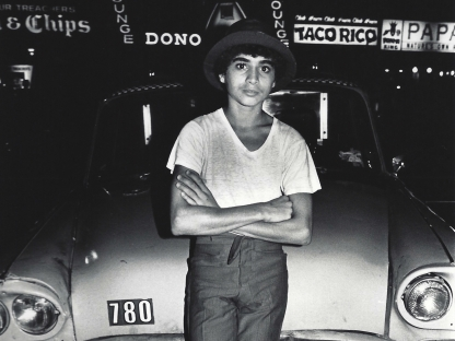 Boy leaning on taxi by Arlene Gottfried