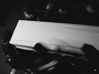 People carrying casket by Stephen Barker