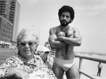 Woman and man on boardwalk by Arlene Gottfried
