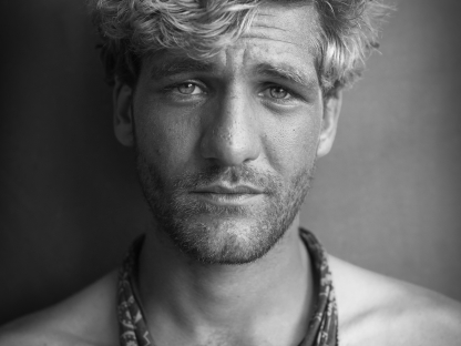 Man with bandana around neck by Michael Joseph