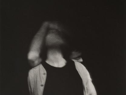 Men embracing in dark by Stephen Barker