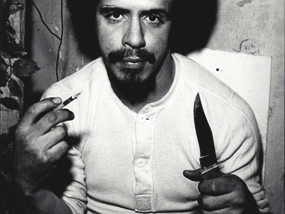Man with knife by Arlene Gottfried