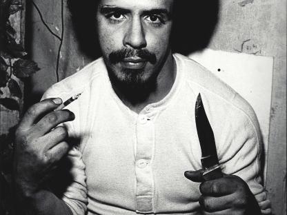 Man with knife by Arlene Gottfried