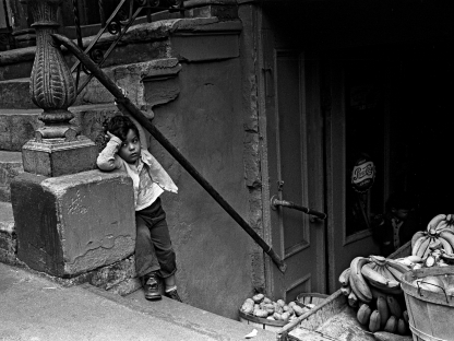 Boy on stairs by Vivian Cherry