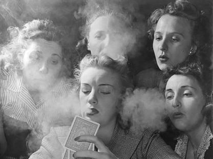 Women smoking by Nina Leen