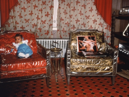 Baby on chair by Arlene Gottfried