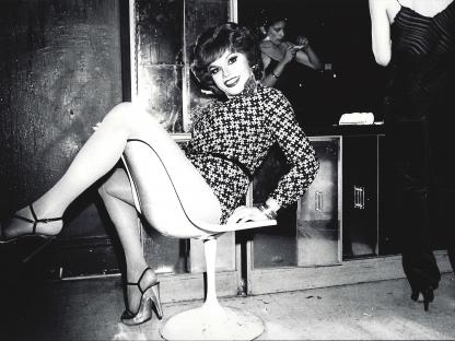 Woman in chair by Arlene Gottfried