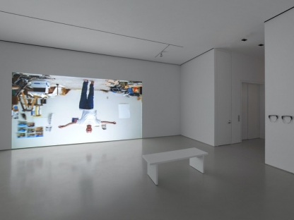 gallery view showing a projection of an upside down man walking with his arms outstretched