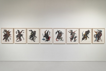 Eight unique and vibrantly colored textile collages hung parallel, each evoking single moving figures, perhaps dancing.