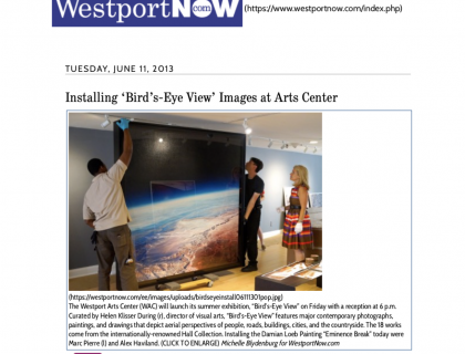 "Photograph of ""Installing 'Bird's-Eye View' Images at Arts Center"""