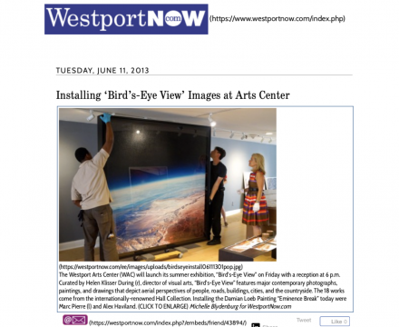 """Photograph of """"Installing 'Bird's-Eye View' Images at Arts Center"""""""