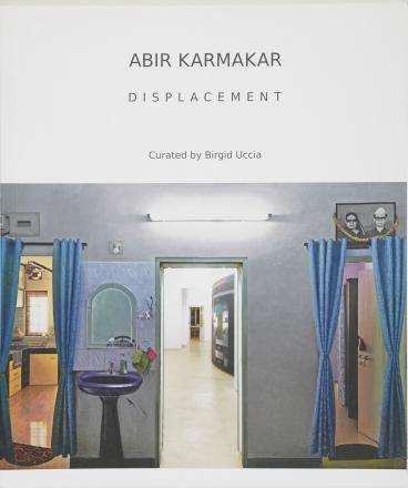 Abir Karmakar, Displacement, catalogue cover, blue walls, room with wash sink
