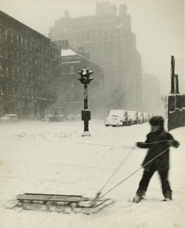 Dan Weiner, Child Playing in Snow, date unknown, Howard Greenberg Gallery, 2019